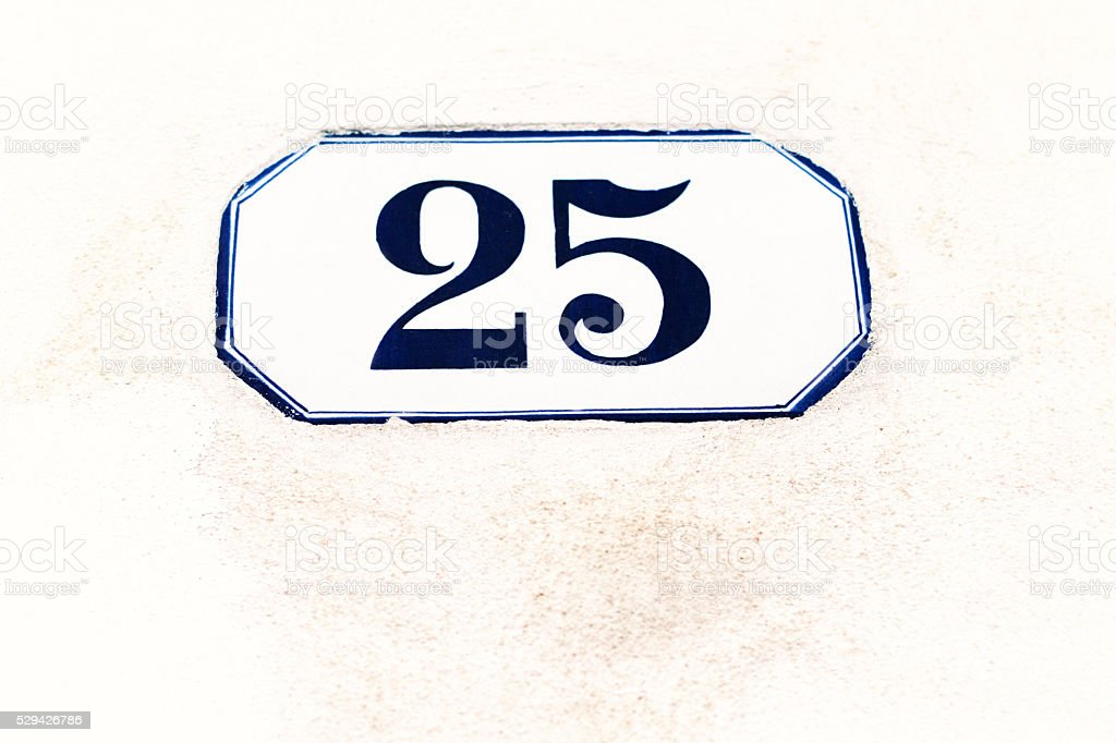 Number 25 Blue and White Vintage Address Tile, White Wall stock photo