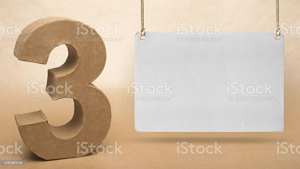 Number 3 on Cardboard stage royalty-free stock photo