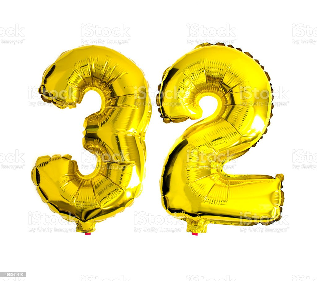 Number 32 written with foil balloons stock photo