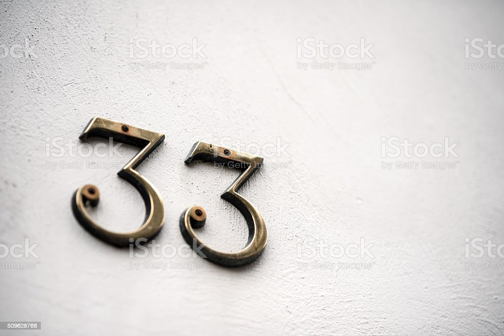 Number 33 on wall stock photo