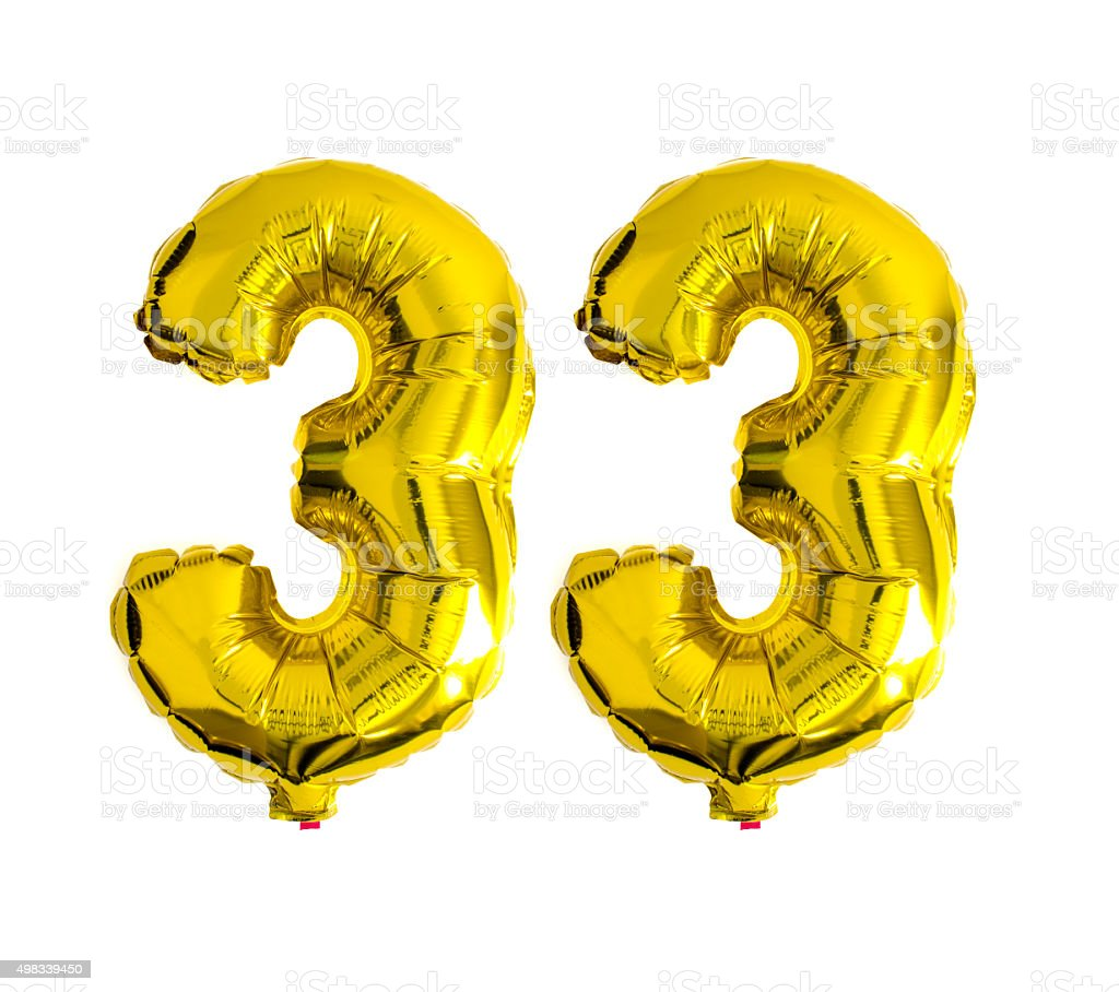 Number 33 written with helium foil balloons stock photo