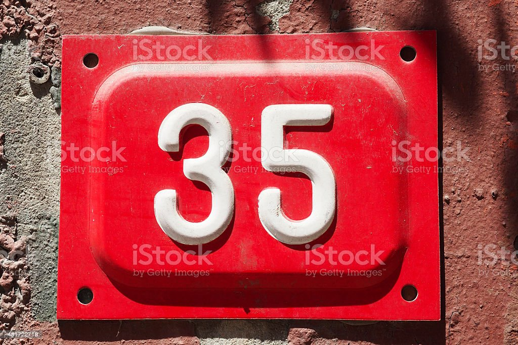 Number 35 on a wall stock photo