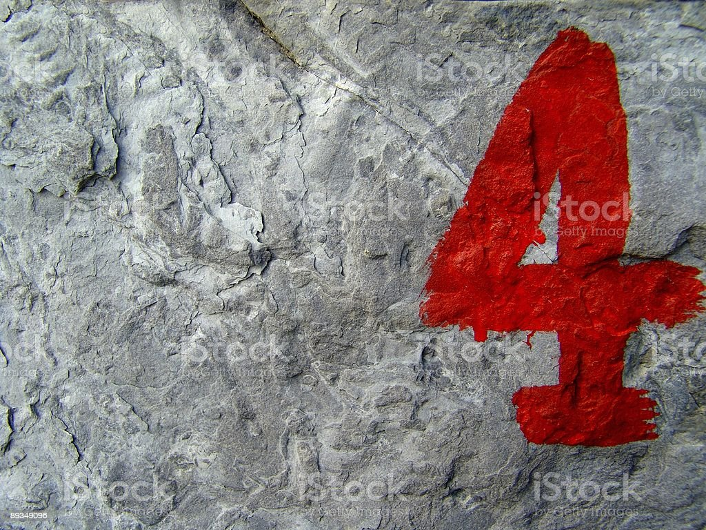 Number 4 on rocks royalty-free stock photo