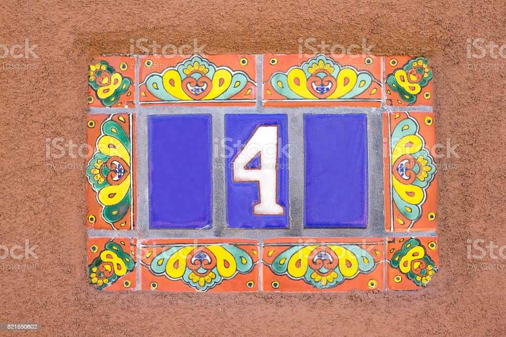 Number 4 Street Address, Colorful Mexican Tiles (Close-Up) stock photo