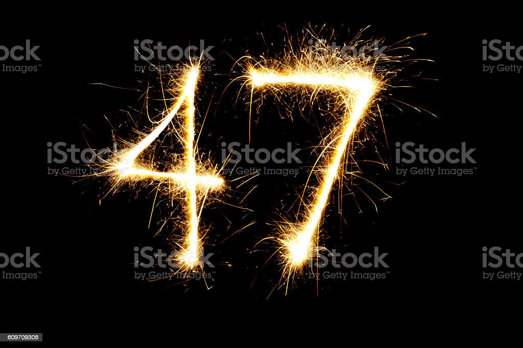 Number 47 made with sparklers stock photo