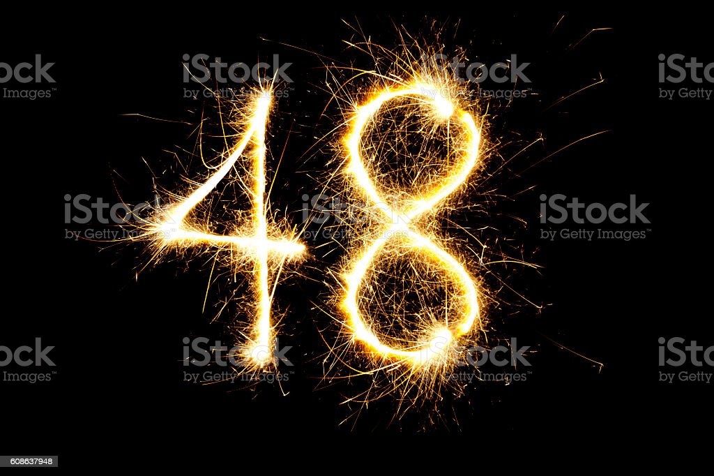 Number 48 made with sparklers stock photo