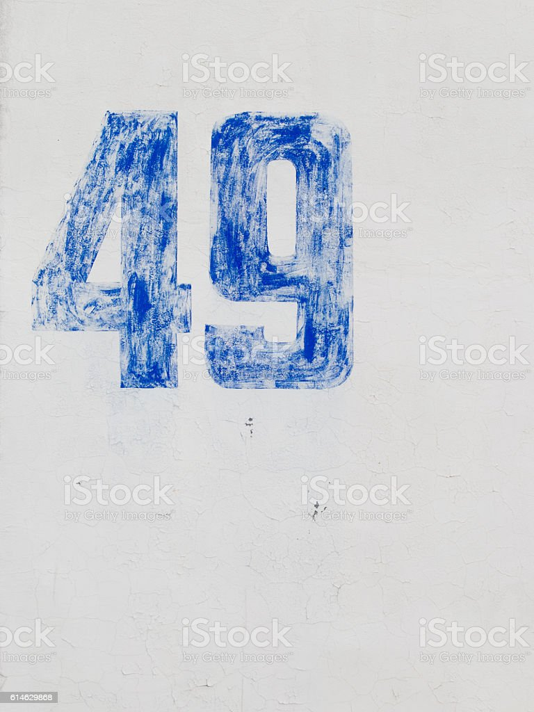 number 49 on a white wall stock photo