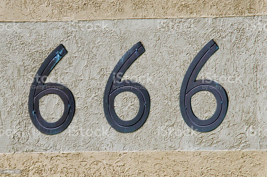 Number 666 sign and symbol stock photo
