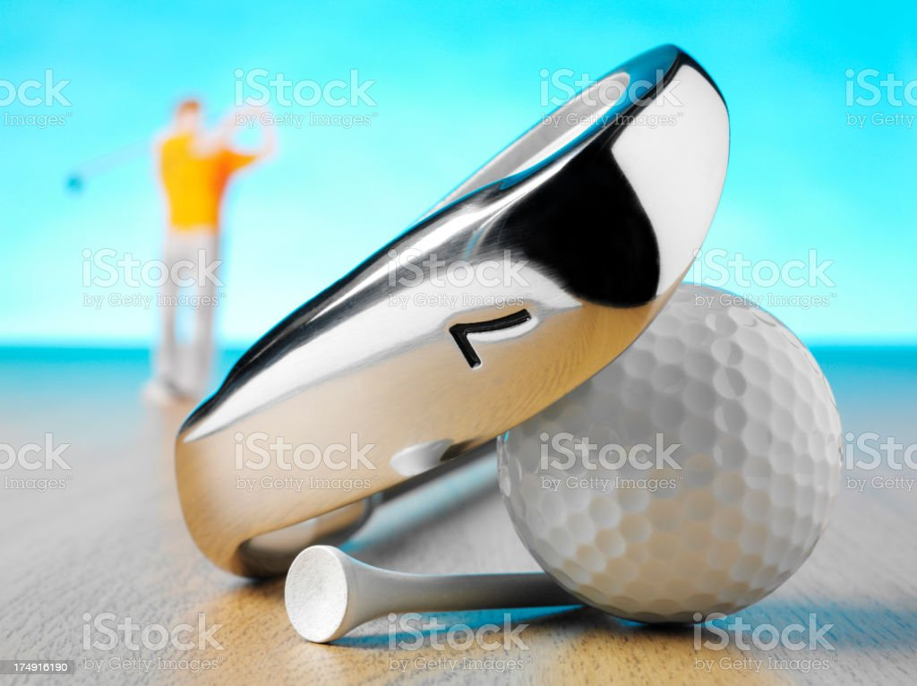 Number 7 Golf Club with a Ball, Tee and Golfer royalty-free stock photo