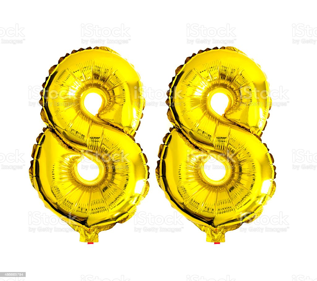Number 88 written with golden foil balloons stock photo