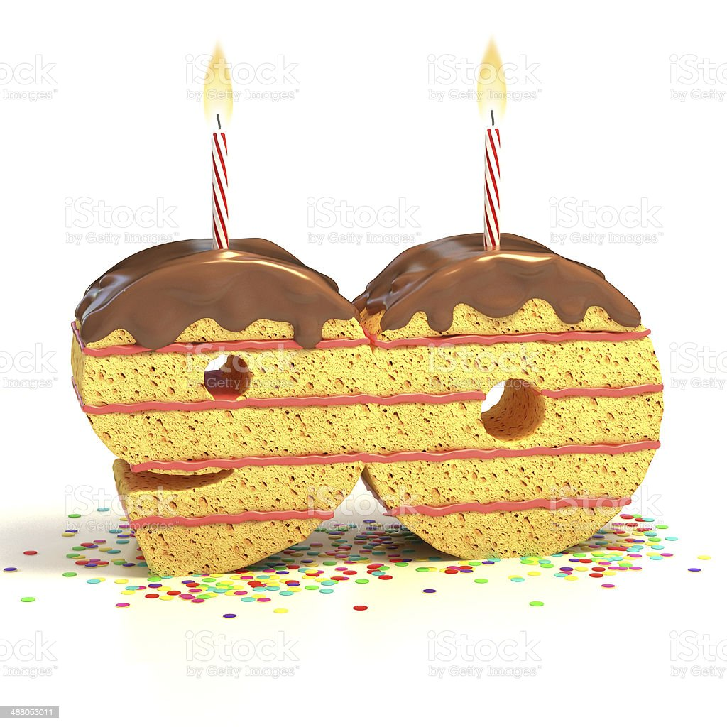 number 90 shaped chocolate birthday cake with lit candle stock photo