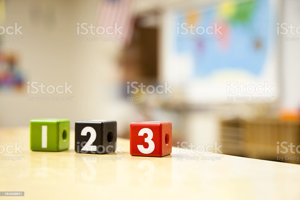 Number blocks on table in elementary school classroom. stock photo