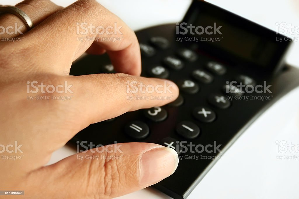 Number Crunching, Fingers on Calculator royalty-free stock photo