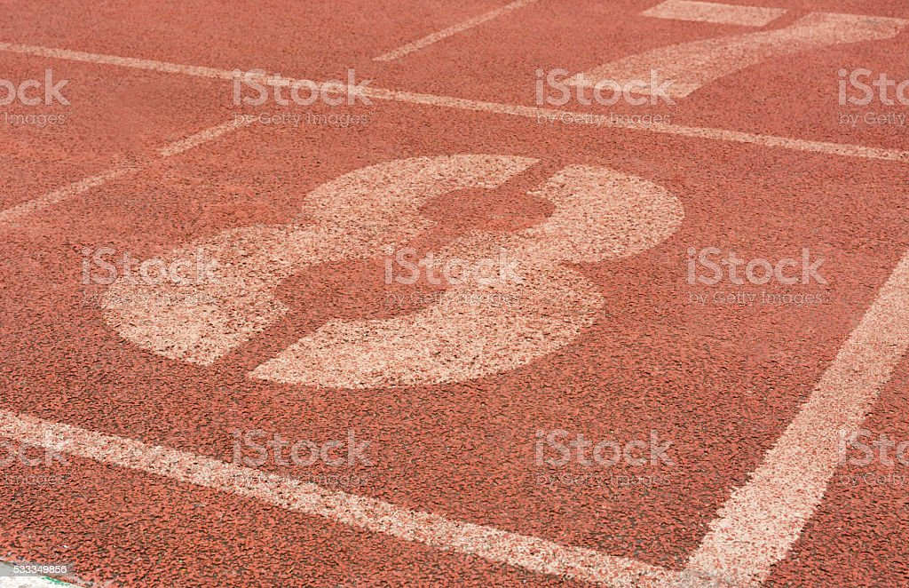 number eight on running race track stock photo