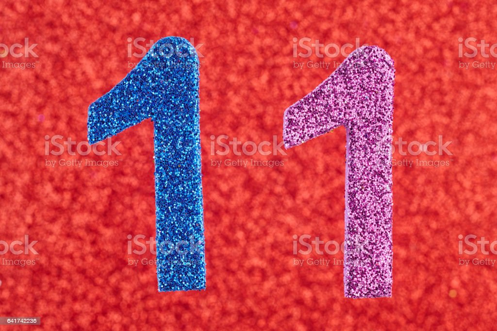 Number eleven blue purple color over a red background. Anniversary. stock photo