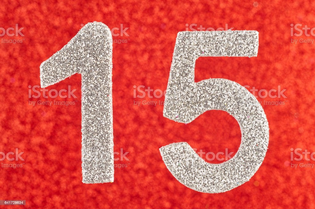 Number fifteen white color over a red background. Anniversary. stock photo