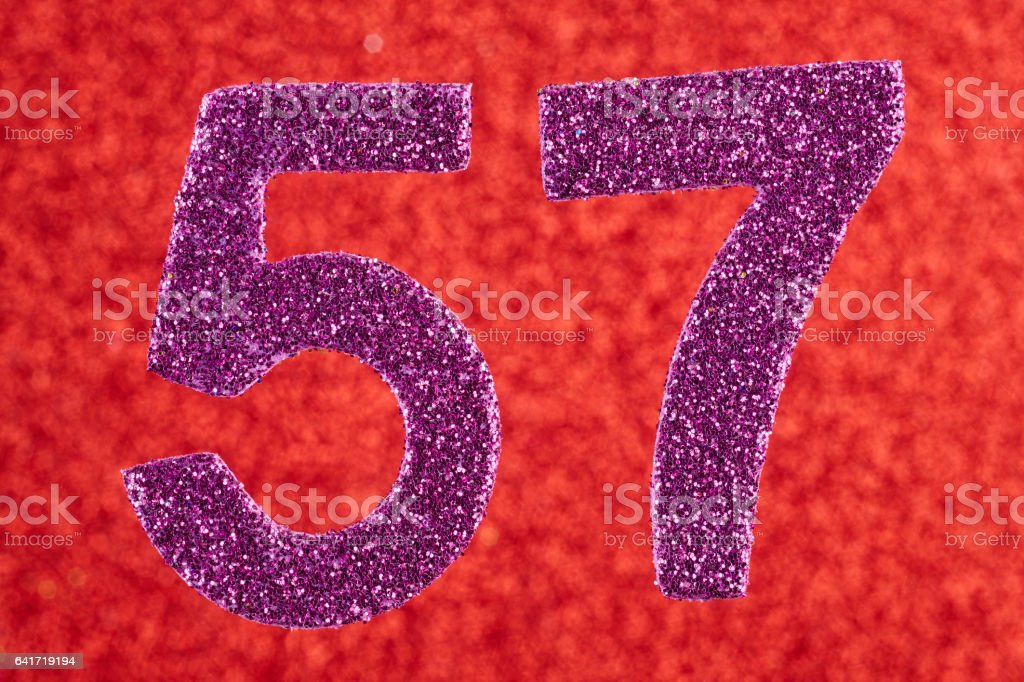 Number fifty-seven purple color over a red background. Anniversary. stock photo