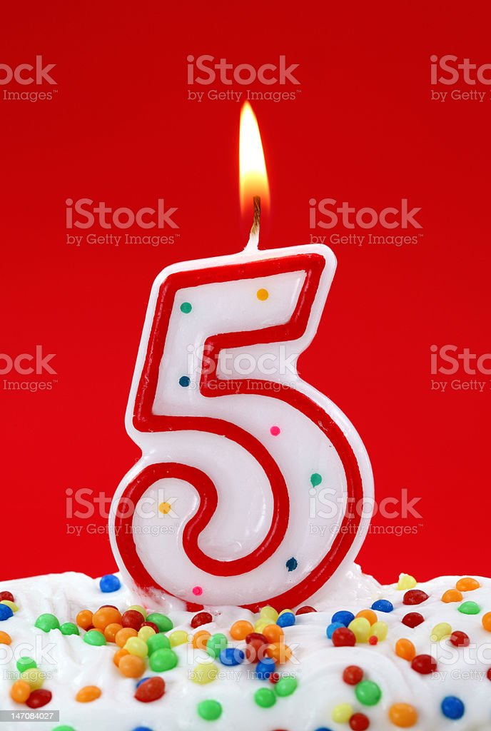 Number five birthday candle stock photo