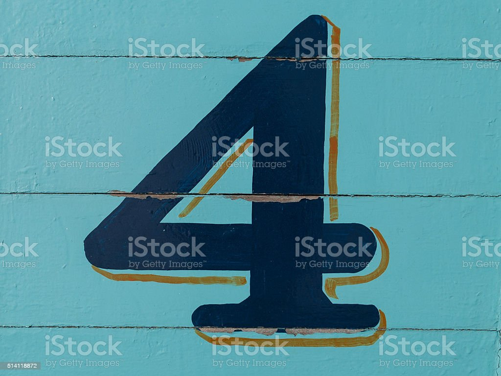 Number four on wooden wall. Number and figure. stock photo