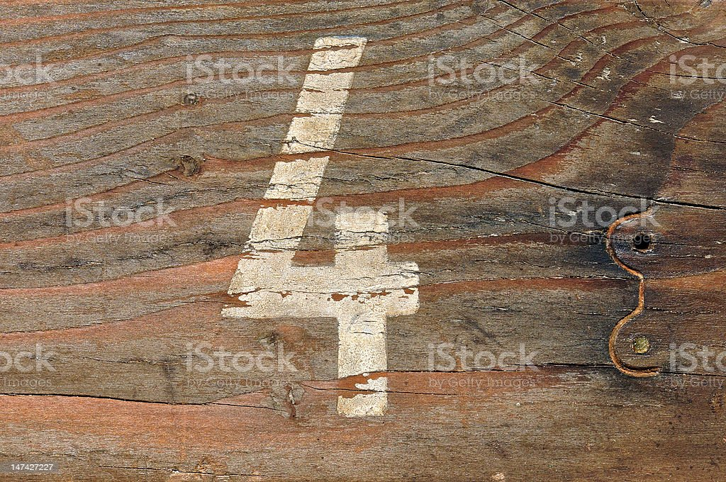 number four wood background stock photo