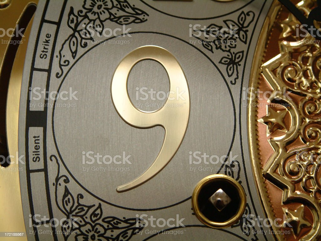 Number nine made of metal on clock royalty-free stock photo