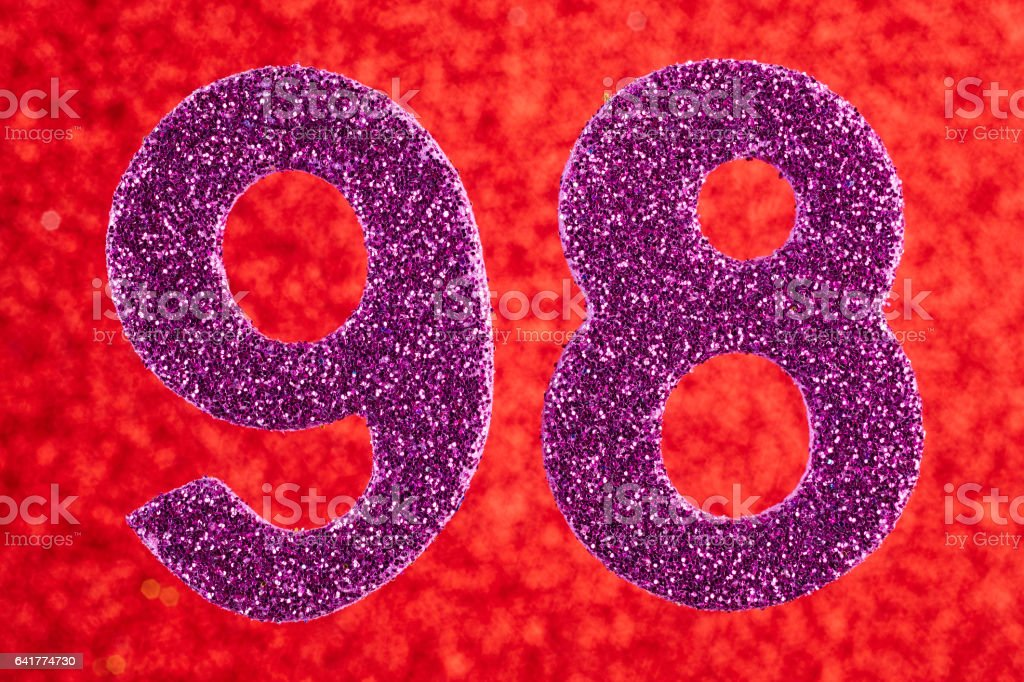 Number ninety-eight purple color over a red background. Anniversary. stock photo