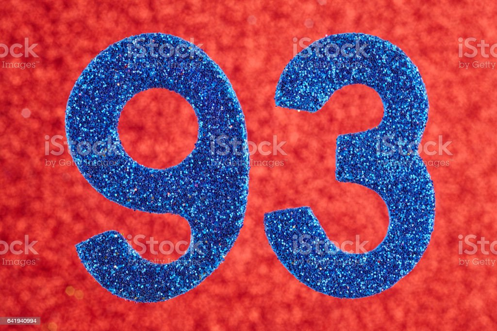 Number ninety-three blue color over a red background. Anniversary. stock photo