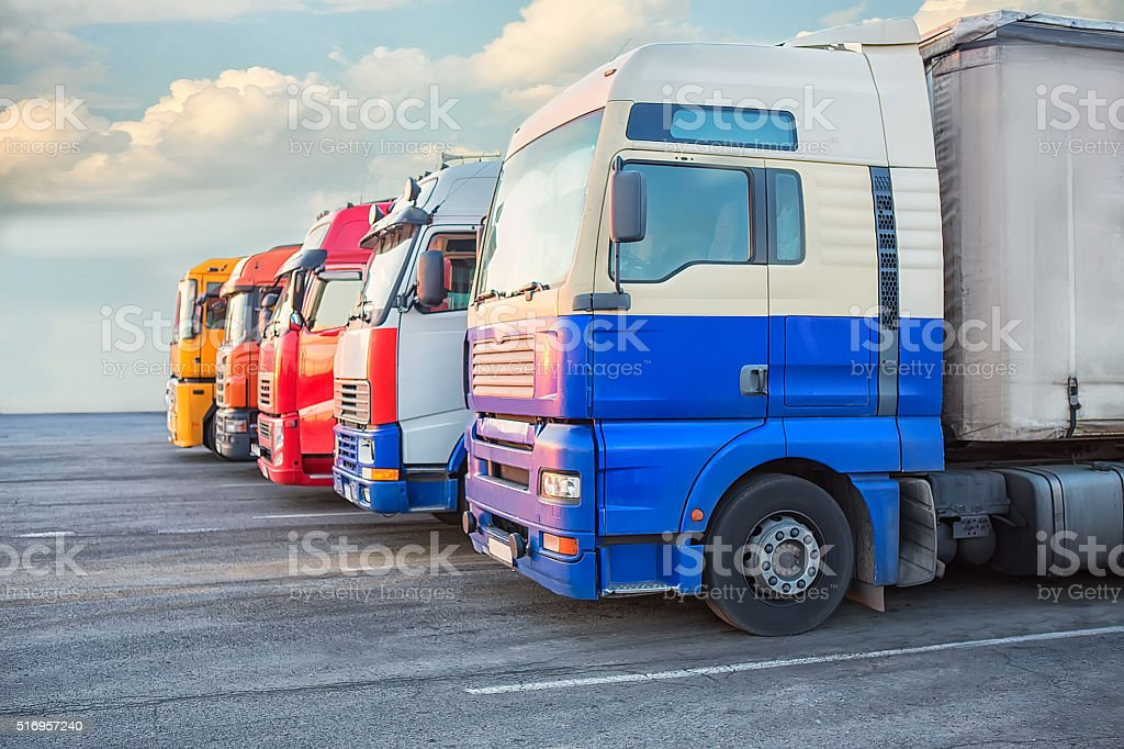 number of big multi-colored trailers stock photo