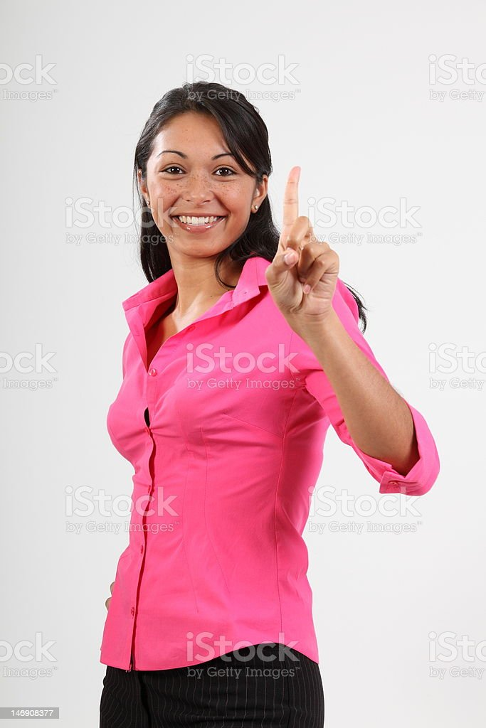 Number one gesture from beautiful young woman wearing pink shirt royalty-free stock photo