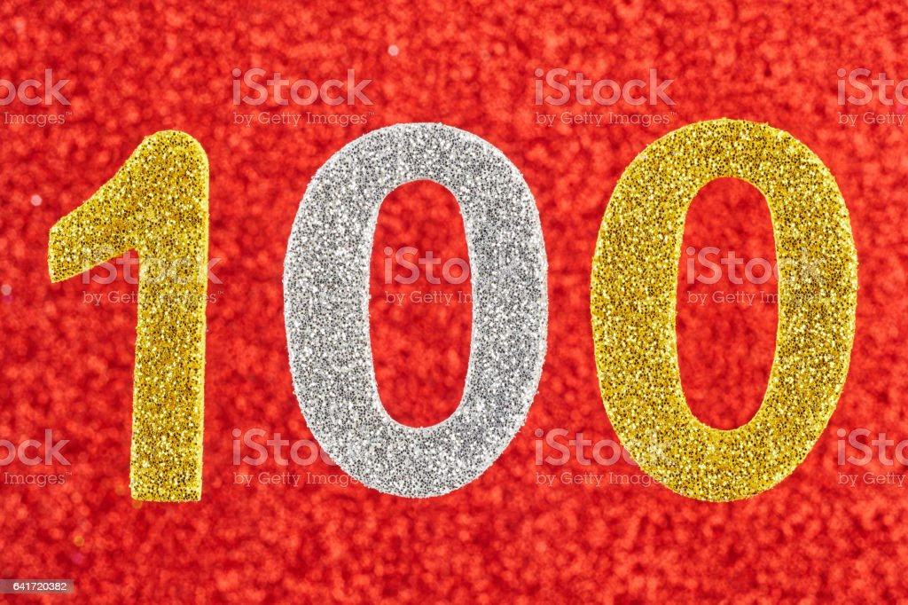 Number one hundred over a red background. Anniversary. stock photo