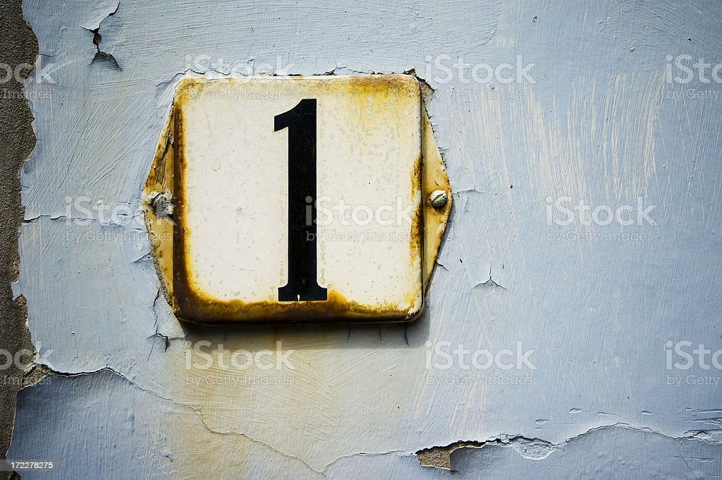 number one on grunge plaster wall royalty-free stock photo