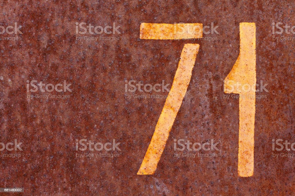 number seventy one on a rusty background stock photo