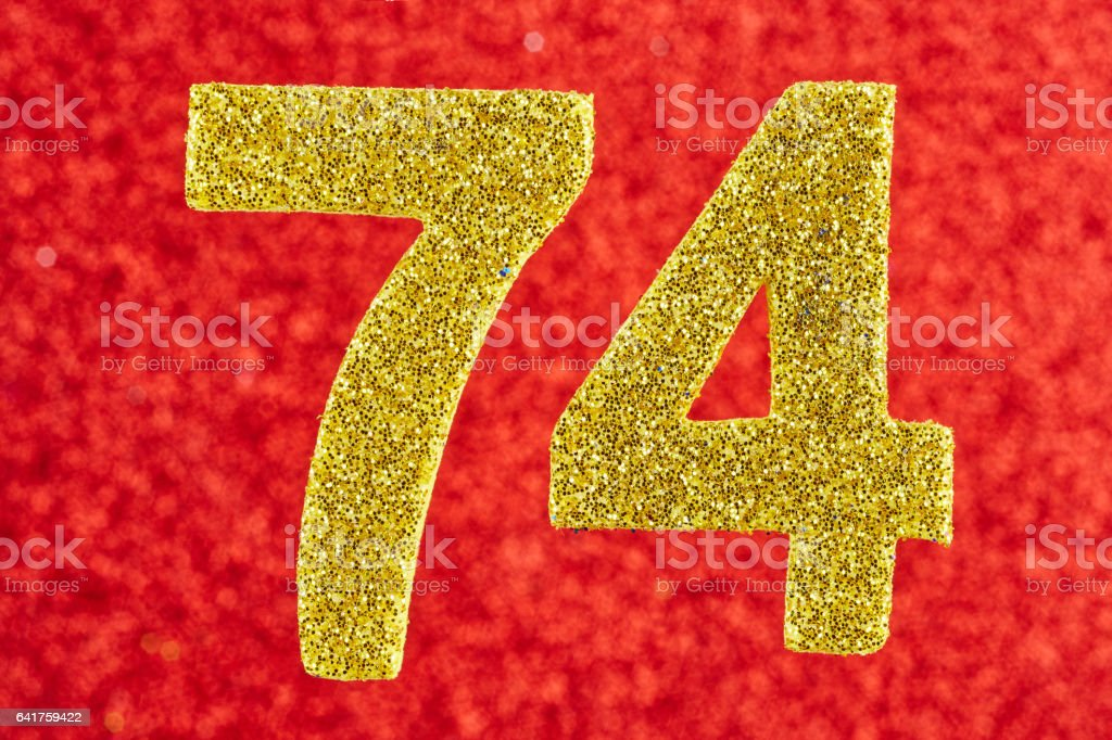 Number seventy-four yellow color over a red background. Anniversary. stock photo