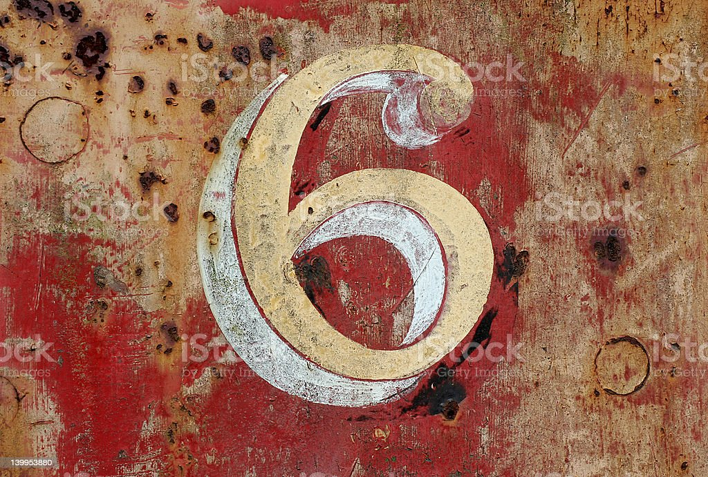 Number six painted on distressed wall royalty-free stock photo