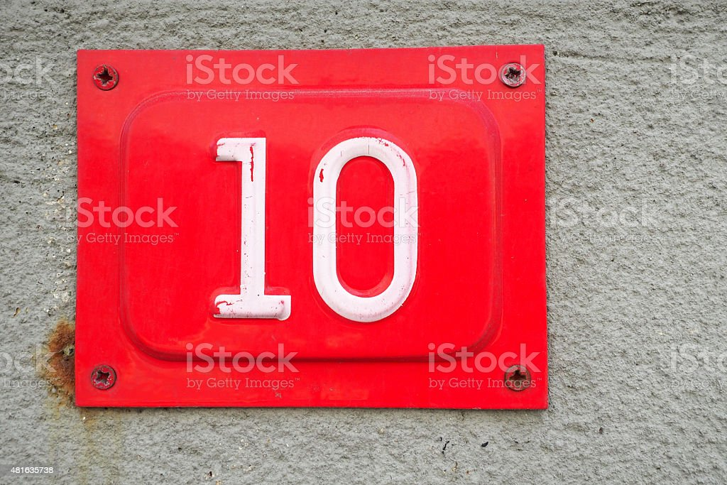 Number ten on a wall stock photo