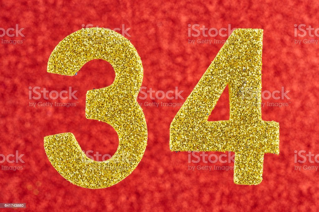 Number thirty-four yellow color over a red background. Anniversary. Horizontal stock photo