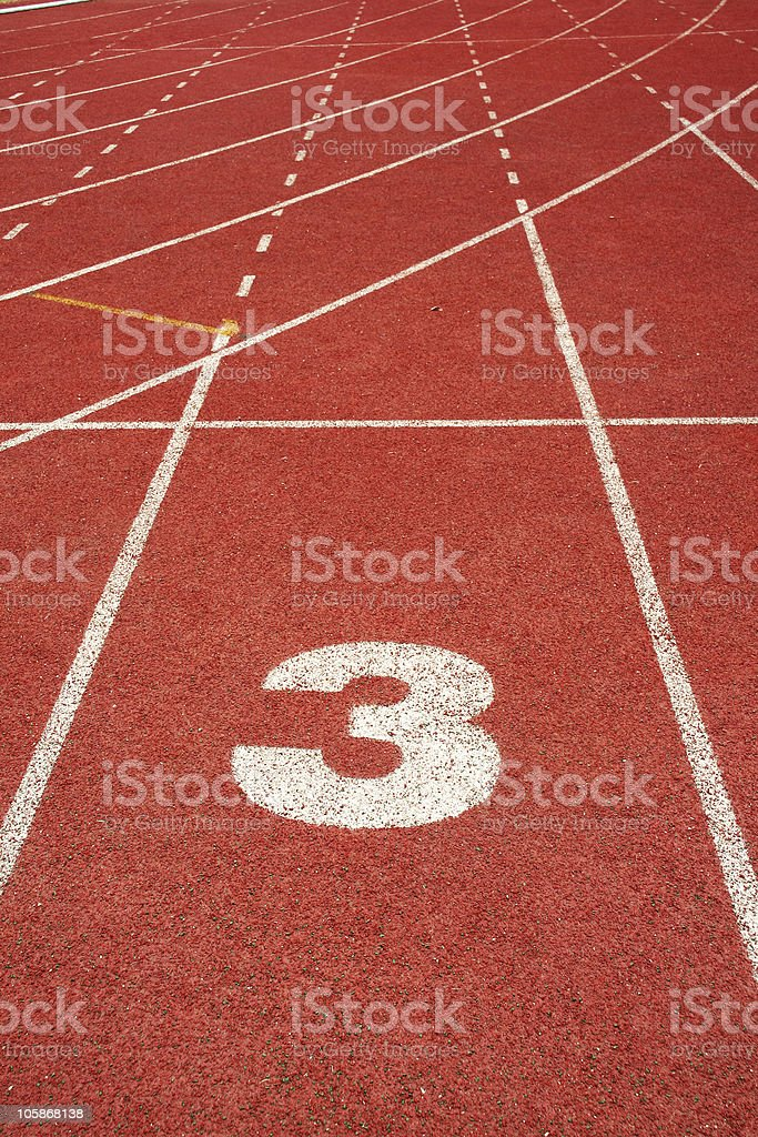 number three on red run track royalty-free stock photo