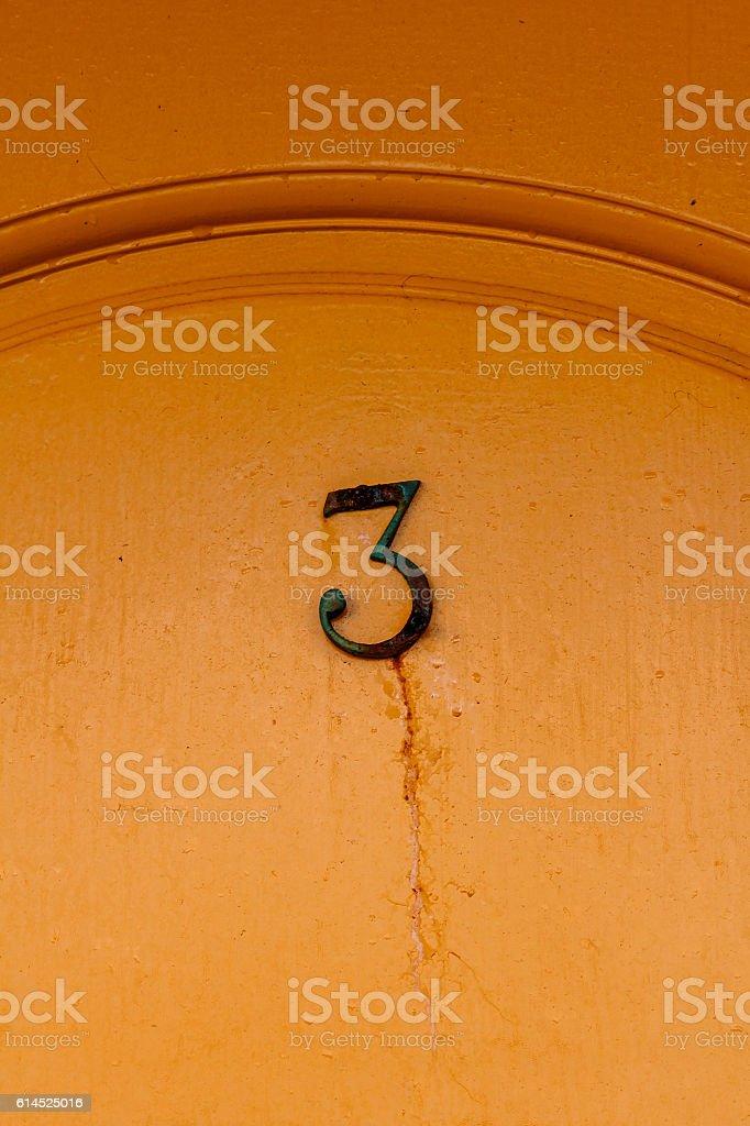 Number three on the door stock photo