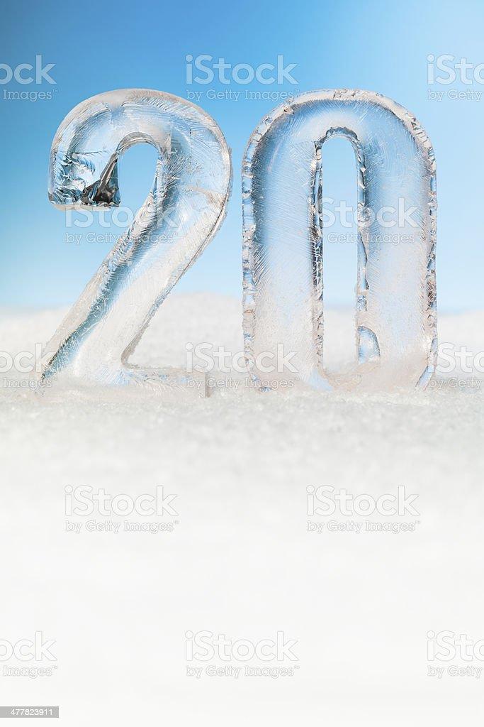 Number twenty ice blocks on snow background stock photo