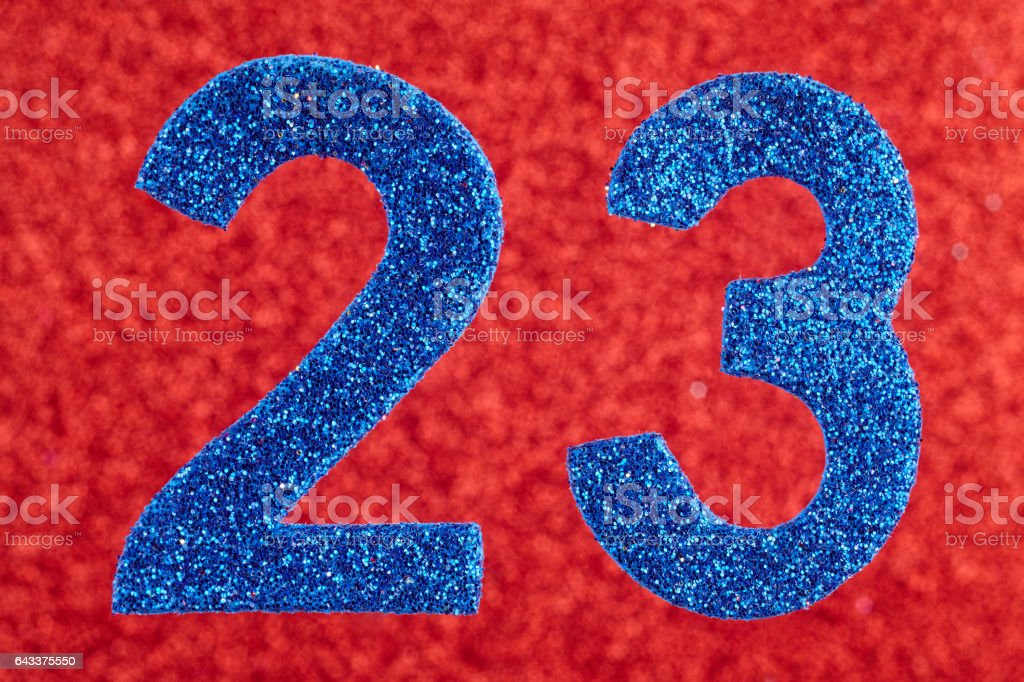Number twenty-three blue over a red background. Anniversary. stock photo