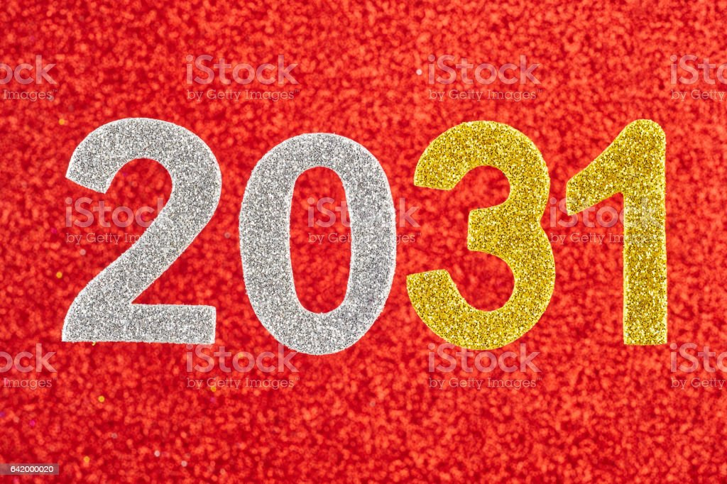 Number two thousand and thirty-one over a red background. Anniversary. stock photo