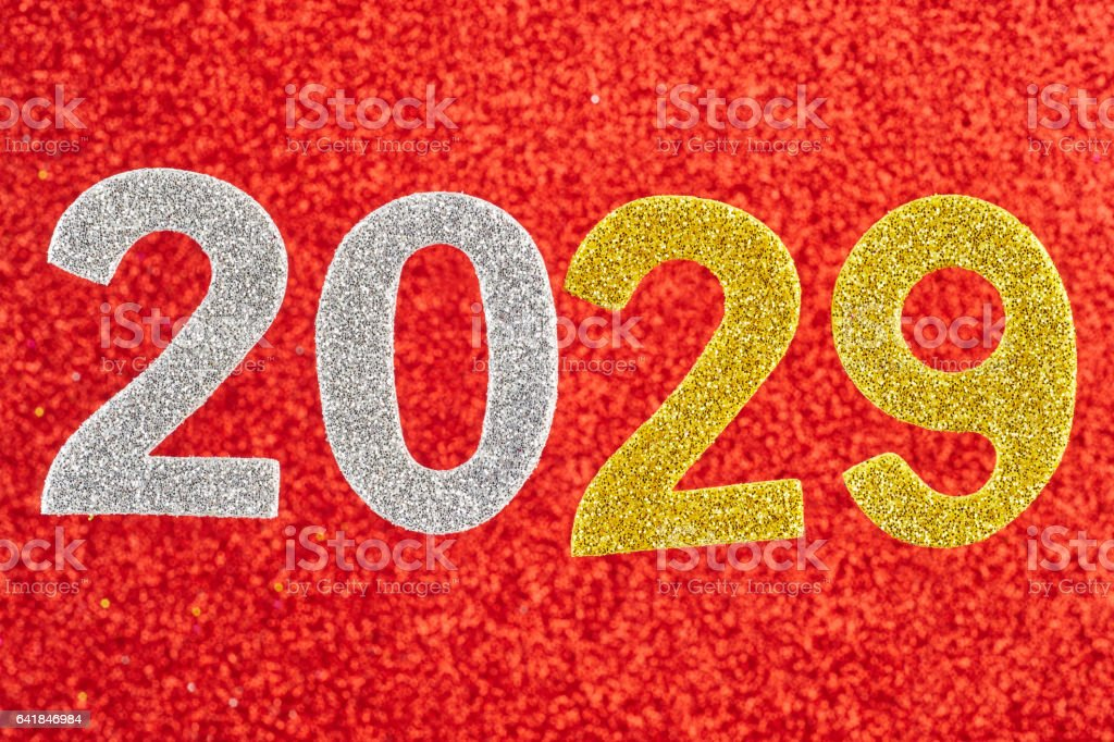Number two thousand and twenty-nine over a red background. Anniversary. stock photo