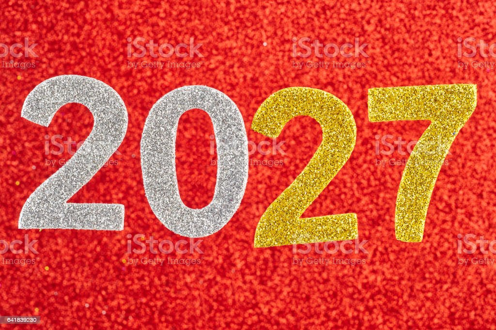 Number two thousand and twenty-seven over a red background. Anniversary. stock photo