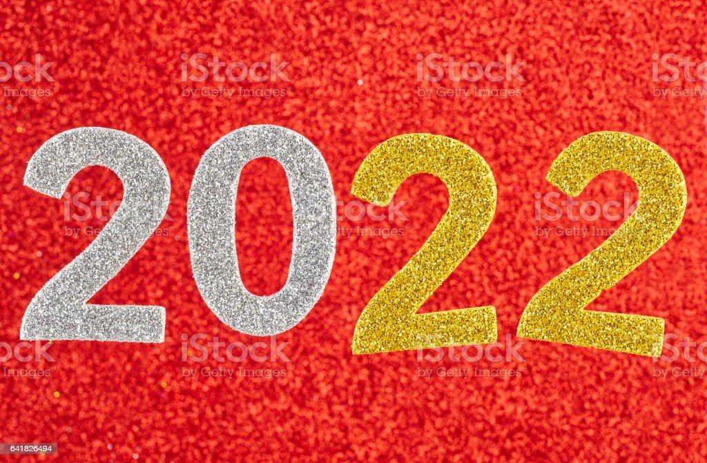 Number two-thousand and twenty one over a red background. Anniversary. stock photo