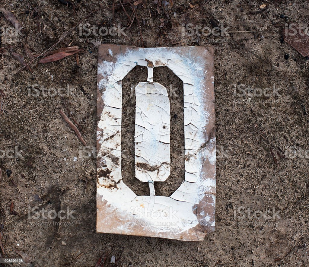Number zero on the old metal stencil stock photo