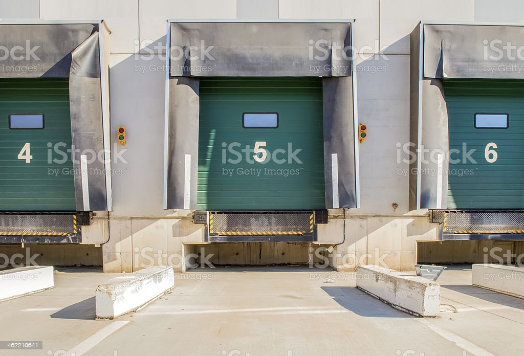 Numbered green loading bays for trucks stock photo