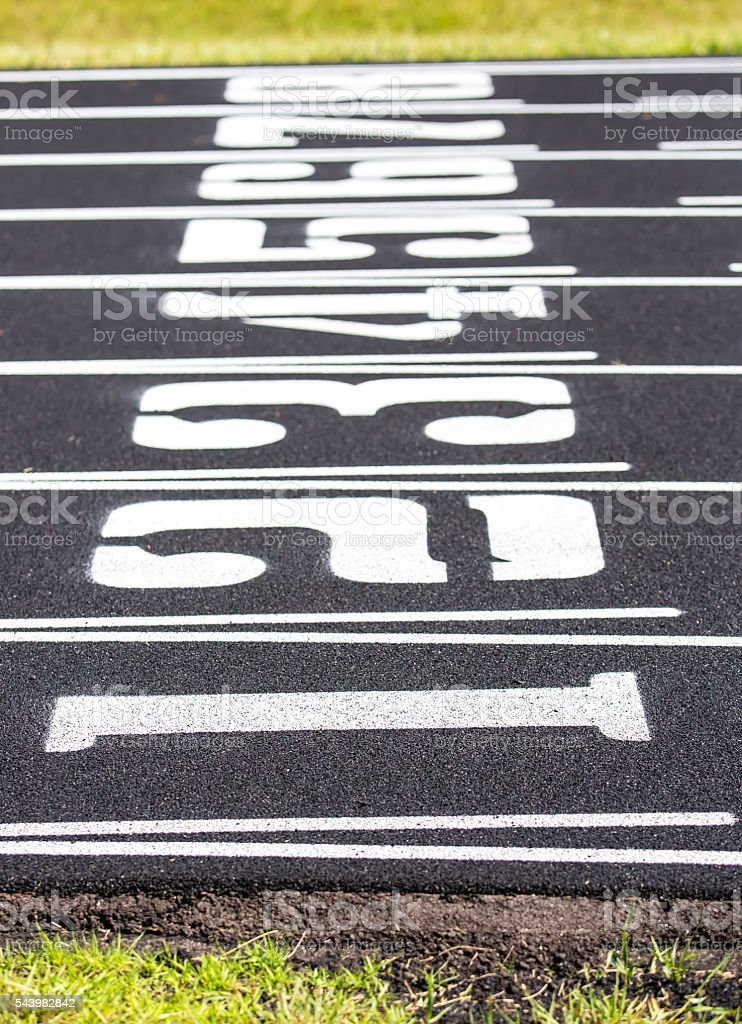 Numbered Lanes on Outdoor Track stock photo
