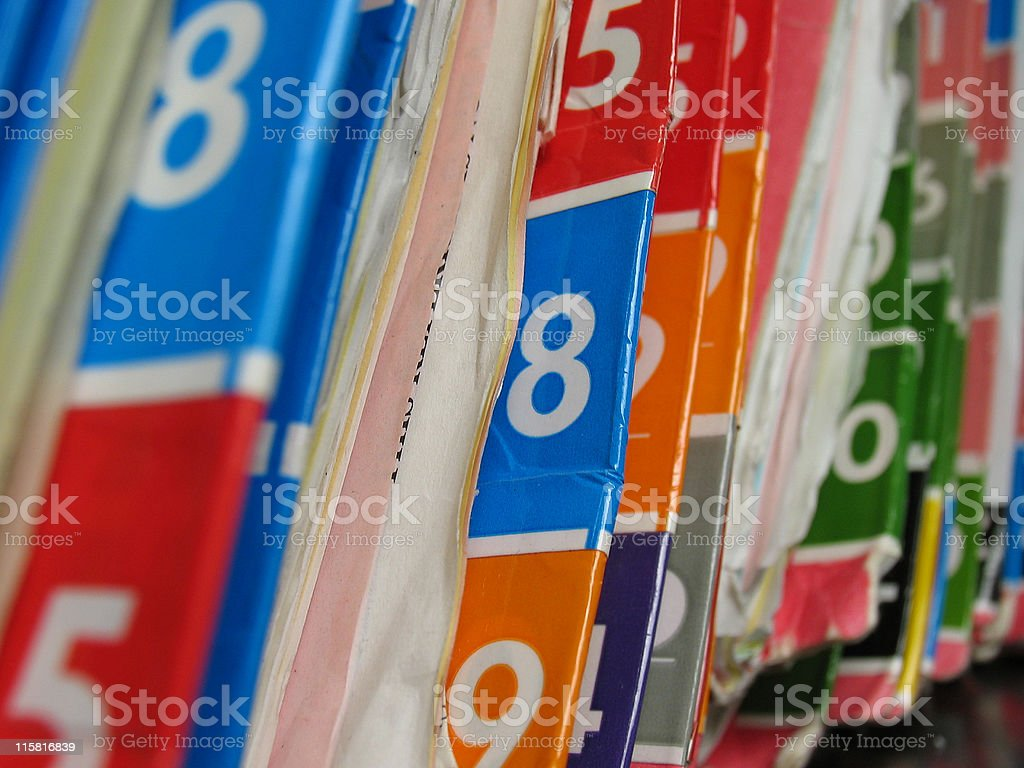 Numbered medical records folders on the shelf. stock photo