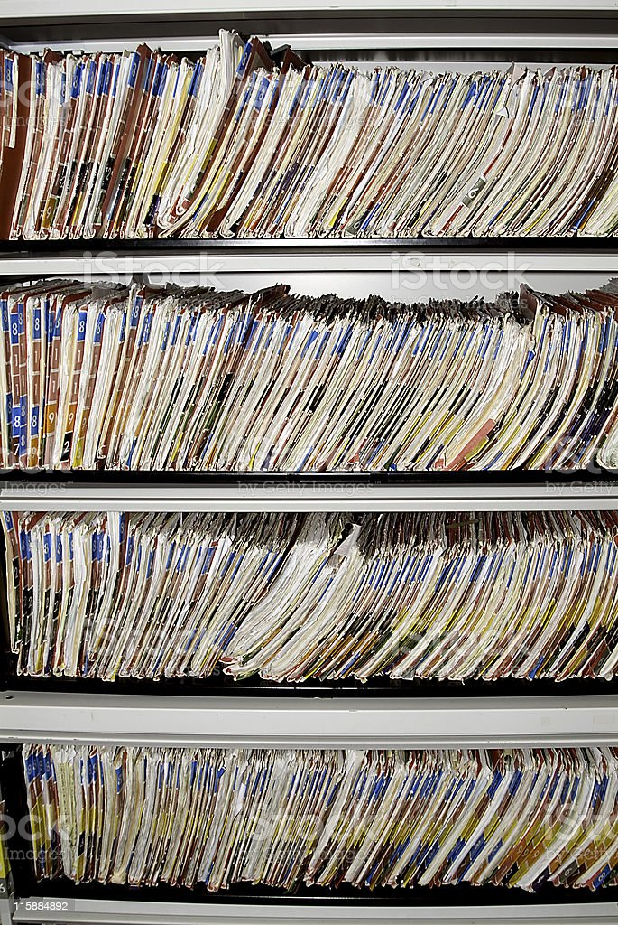 Numbered medical records folders on the shelf. royalty-free stock photo