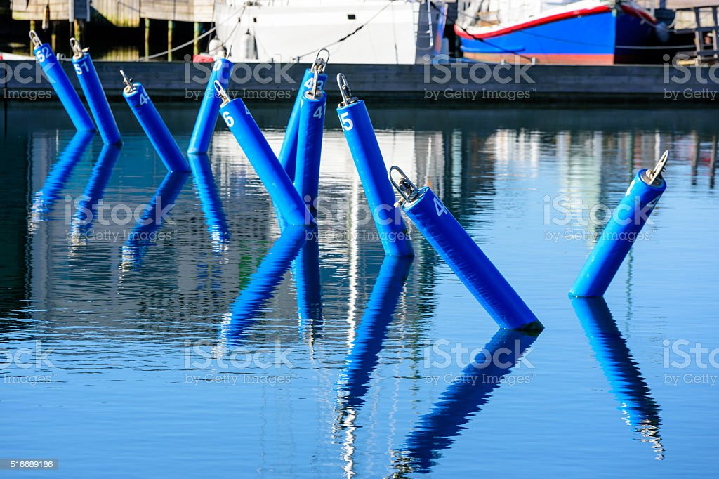 Numbered mooring places stock photo